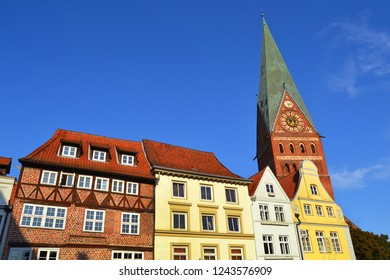 Typical German houses and St. John's Church on the background. Luneburg, Germany, Europe.