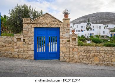 A typical Greek blue entrance gate on the Greek island of Folegandros. Cyclades, Greece