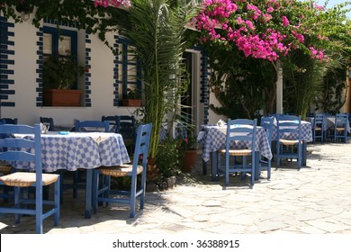 Typical greek taverna with tables outside in the yard
