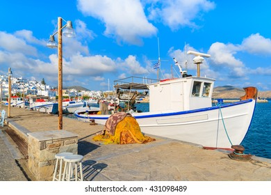 Typical Greek white fishing boat in Naoussa port, Paros island, Cyclades, Greece