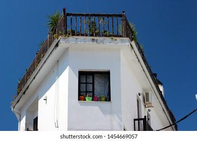 Typical Greek window with flowers in Window Pots. Skiathos, Greece.