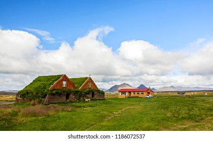 typical green houses with gras roof in iceland - iceland