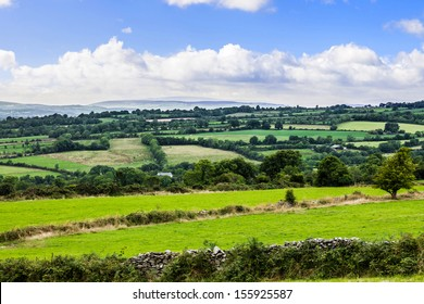 Typical green Irish country side with rolling fields and green patches