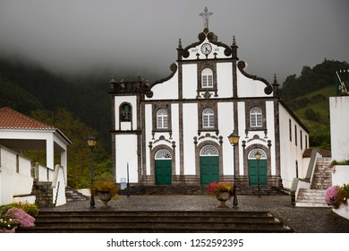 typical historic Portuguese catholic church of the azores islands front entrance