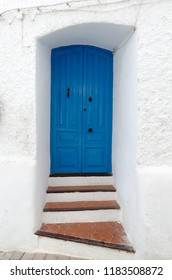 typical house door painted in blue in mojacar, Almeria, Andalusia, Spain