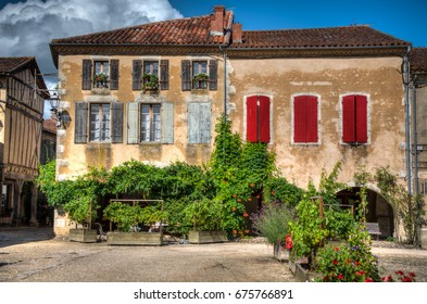 Typical house in Labastide d'Armagnac in Gascony, Aquitaine, France on a bright Summer day.