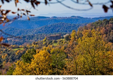 Typical house (Masia) Mountains and autumn forest with oaks and pines between Osona an llucanes.