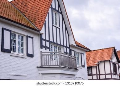 Typical house on Belgian north sea coast with timber framing (vakwerk) in De Haan. Traditional architecture in De Haan, Flanders, Belgium.