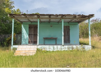 Typical house in the Saintes island, Guadeloupe, in a field, with a roof to protect from the sun