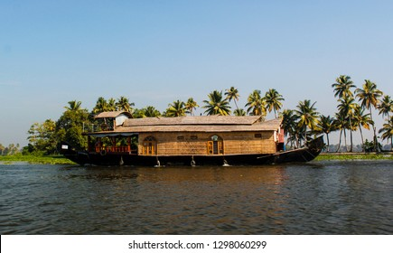 A typical houseboat on Periyar backwaters in Kerala, the houseboats are common mode of spending Holidays on these houseboats where a rooms, kitchen, cook, bathrooms etc amenities are available