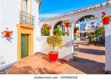 Typical houses decorated with flowers in small village near Marbella. Andalusia, Spain