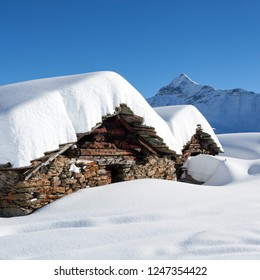 Typical huts in Valtellina - Italy - Panoramic winter view