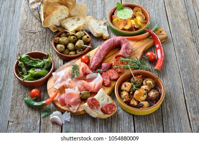 Typical Iberian bar food: Spicy chorizo sausage, Serrano ham and other mixed tapas