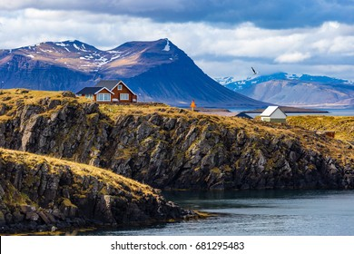 Typical Icelandic landscape with houses against mountains in small village of Stykkisholmur, Western Iceland