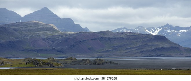 Typical icelandic landscape. Mountains and Seashore of the Atlantic Ocean.