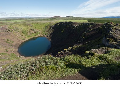 Typical Icelandic landscape, a wild nature of rocks and shrubs, volcano and lakes.