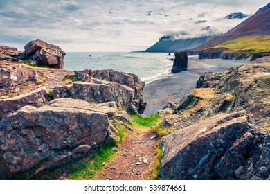 Typical Icelandic seascape with black basalt sand. Dramatic summer morning on the west coast of Iceland, Europe. Artistic style post processed photo