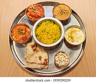 Typical Indian dish Thali. Vegetarian dishes on one large round plate.