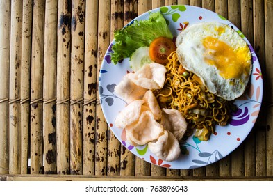 Typical Indonesian dish mie goreng copy space left.