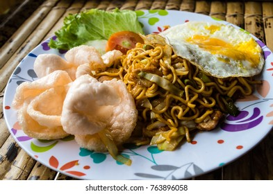 Typical Indonesian dish mie goreng close up full plate.