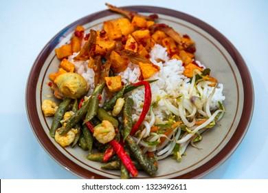 Typical Indonesian nasi campur or mixed rice or warung food