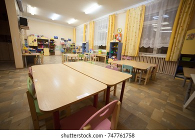 Typical interior of a russian kindergarten in yellow and green colors. Panoramic view.