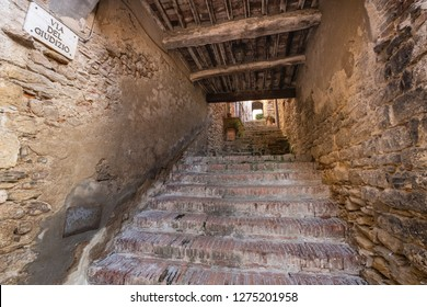 Typical internal road with stairways to reach the historical part of the medieval village of Suvereto, province of Livorno, Tuscany, Italy