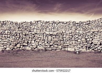 Typical Irish wall to divide pastures (Ireland) - toned image