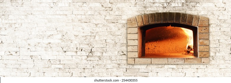 Typical Italian oven for bread and pizza. Nice fire light and colors. Horizontal photo with bricks texture.