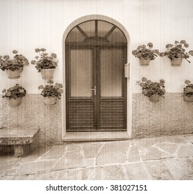 Is a typical italian street in the a small provincial town in Tuscany, Italy, Europe. Old style. Sepia