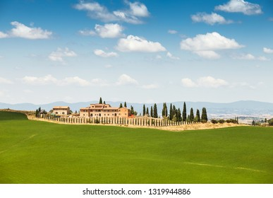 Typical Italian villa on the green field in Tuscany