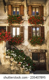 typical italian windows on a building facade in Pescocostanzo, Italy