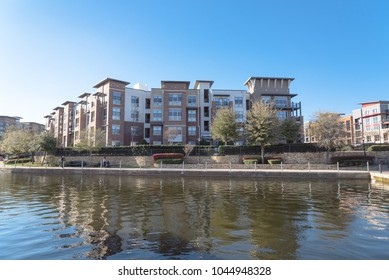 Typical lakeside apartment building complex at Lake Carolyn, Las Colinas, Irving, Texas. Clear blue sky.