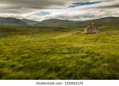typical landscape with ancient ruins and endless pastures and pastures, Sutherland, Highlands, Scotland