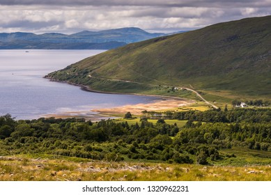 Typical landscape with coast, houses and pastures on the Gaelic peninsula Applecross, Strathcarron, Inner Hebrides, Scotland, UK