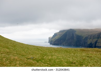 Typical landscape on the Faroe Islands, with green grass and cliff on the northern edge of Eysturoy