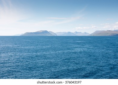 Typical landscape on the Faroe Islands as seen from a ship with Sandoy