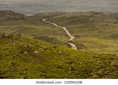 Typical landscape with street and pastures on the Gaelic peninsula Applecross, Strathcarron, Inner Hebrides, Scotland, UK