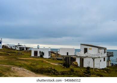 Typical landscape in Uruguay with white houses scattered surrounded by green vegetation