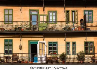 Typical Ljubljana old town apartments with balconies on the riverside of Ljubljanica river in Ljubljana, Slovenia
