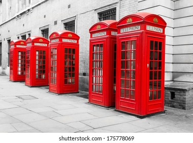 Typical London Red Telephone Boxes on a black and white background