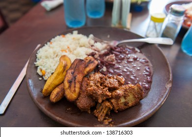 A typical lunch of pork,beans, plantains and rice in Nicaragua