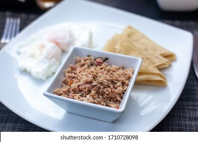 A typical Maldivian breakfast, Mas Huni, made with coconut and tuna. - Shutterstock ID 1710728098