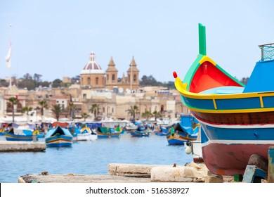 Typical maltese boats moored in the fishermen village Marsaxlokk on the Malta island.