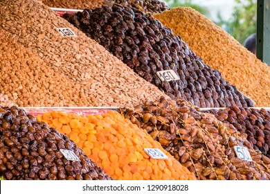 A typical market stall selling nuts, dried fruits and dates to tourists in Marrakech