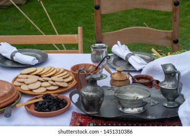 Typical Medieval food table with biscuits and pewter