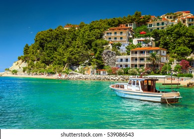 Typical mediterranean houses and fishing motorboat, Makarska riviera, Brela, Dalmatia, Croatia, Europe