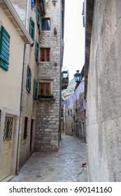 Typical Mediterranean street in the old town of Kotor with a loundry above.