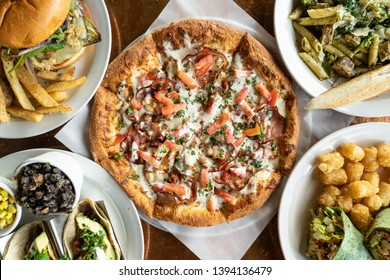 Typical menu items served in an American bar or pub. Delicious but unhealthy pizza and burgers.