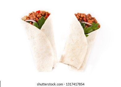 Typical Mexican burritos wraps with beef, frijoles and vegetables isolated on white background. Top view